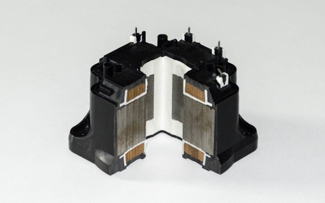 Overmolded stator